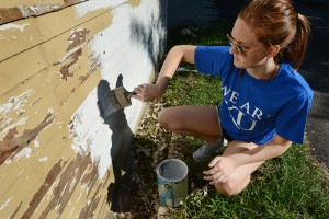 KU Medical Center students help paint a house with minor home repair